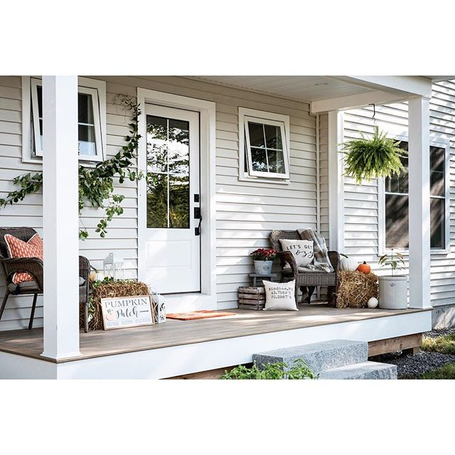 🍁🍂 Our Autumn decor mantra is when in doubt, put a pumpkin on it! • One of our homeowners Kristina Clarke of @sisterhoodrestoration has styled her farmhouse porch accordingly🎃 We wouldn't mind kicking back and enjoying a crisp morning out there on the deck. . . . . . #mainehomes #mainehomedesign #frontdoordecor #modernfarmhouse #fallfarmhousedecor #falldecor #generalcontractor #mainebuilders #mainelife #autumnmornings #buildersofig #contractorsofinsta #frontporch #liveauthentic #shabbychicstyle