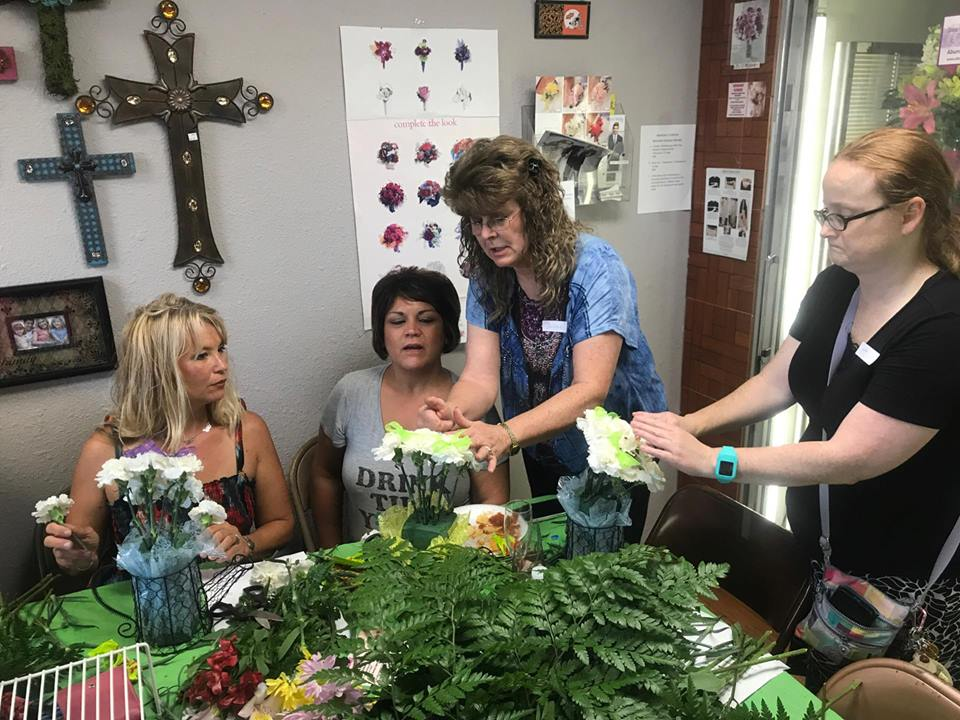 Owner Debbie Wesley giving one on one help to some of the members of the class.