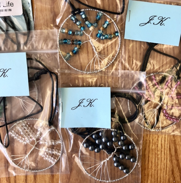 A few of Joshua's Tree of Life Necklaces. Buy one online or in store at Andee's!