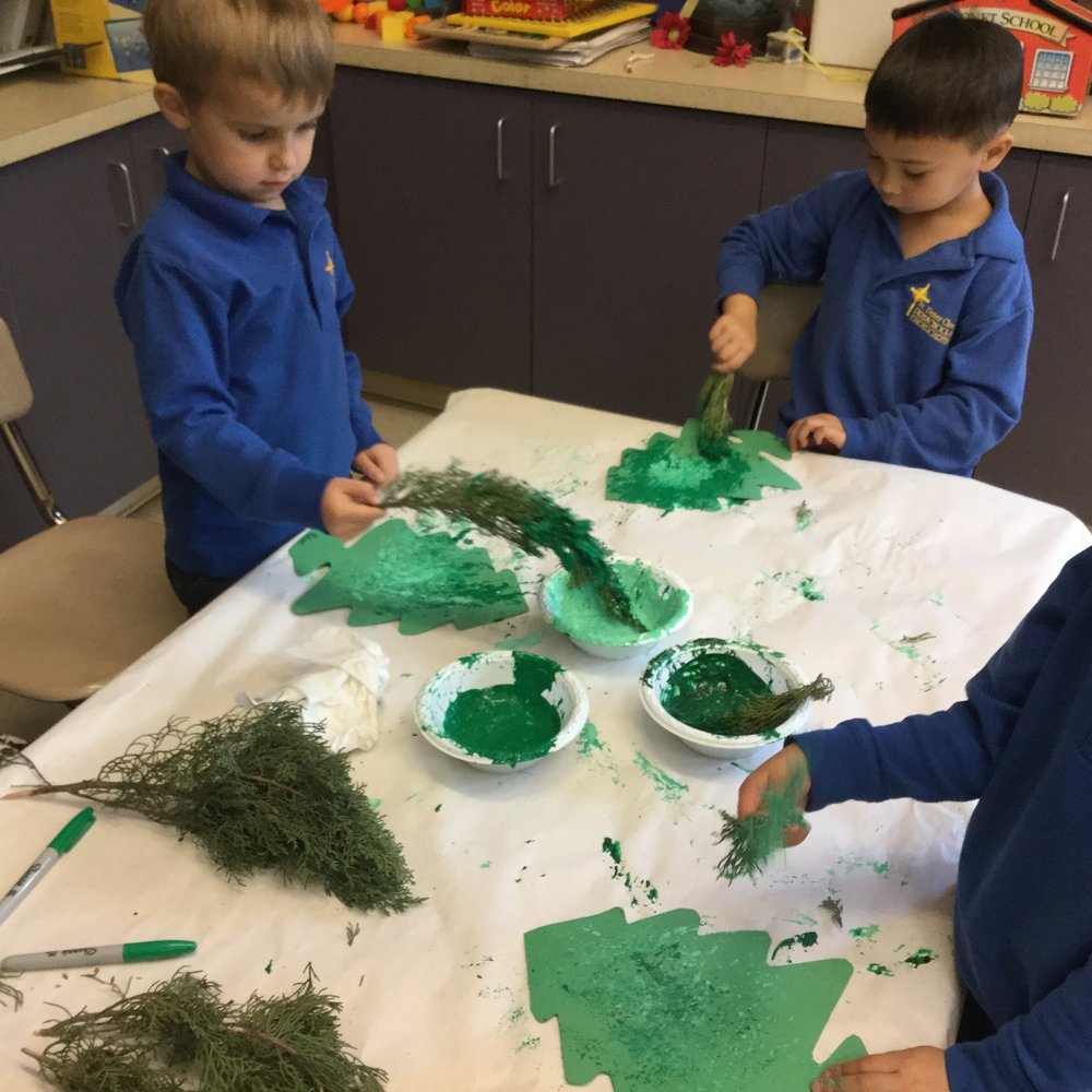 Painting with evergreens.