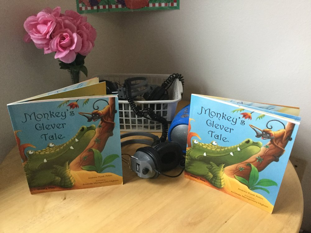 "We started our week with a new listening center story.  The children seem to enjoy the funny antics of ""Monkey's Clever Tale"""