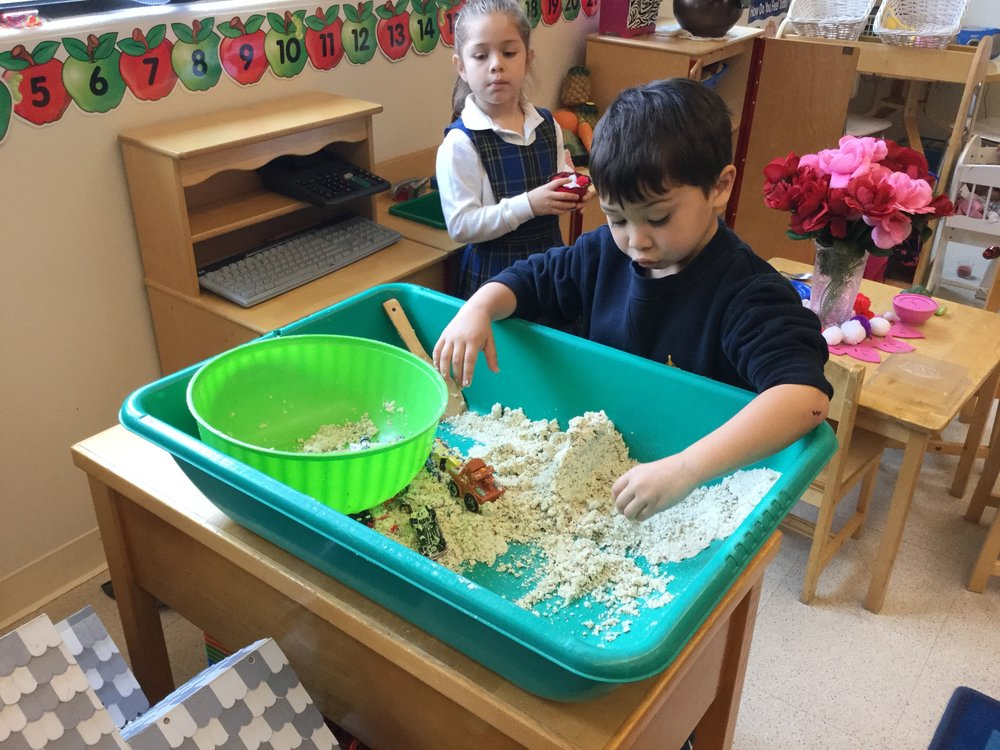 Sensory play at its best. We made play sand out of flour and baby oil. The children enjoyed shaping it into mountains and maneuvering the cars through it.