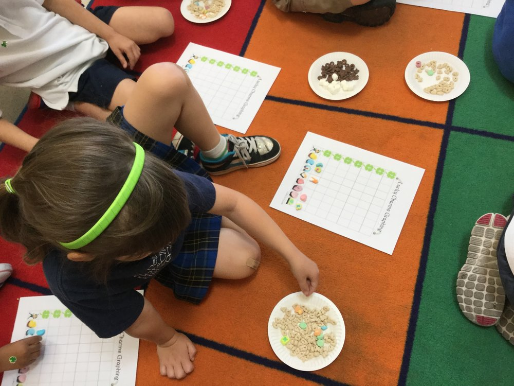 The children are seen here sorting and classifying the different cereal shapes.
