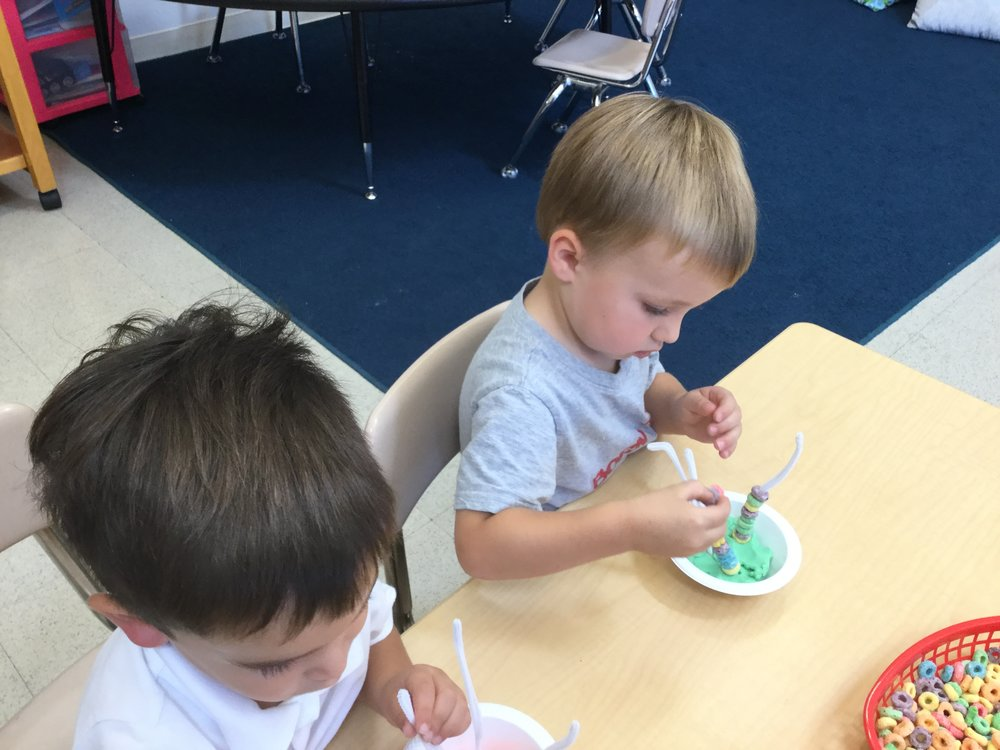 Using our finger grasp putting fruit loops on pipe cleaners.