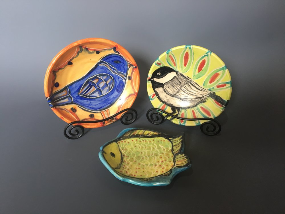 painted pottery plates and dishes