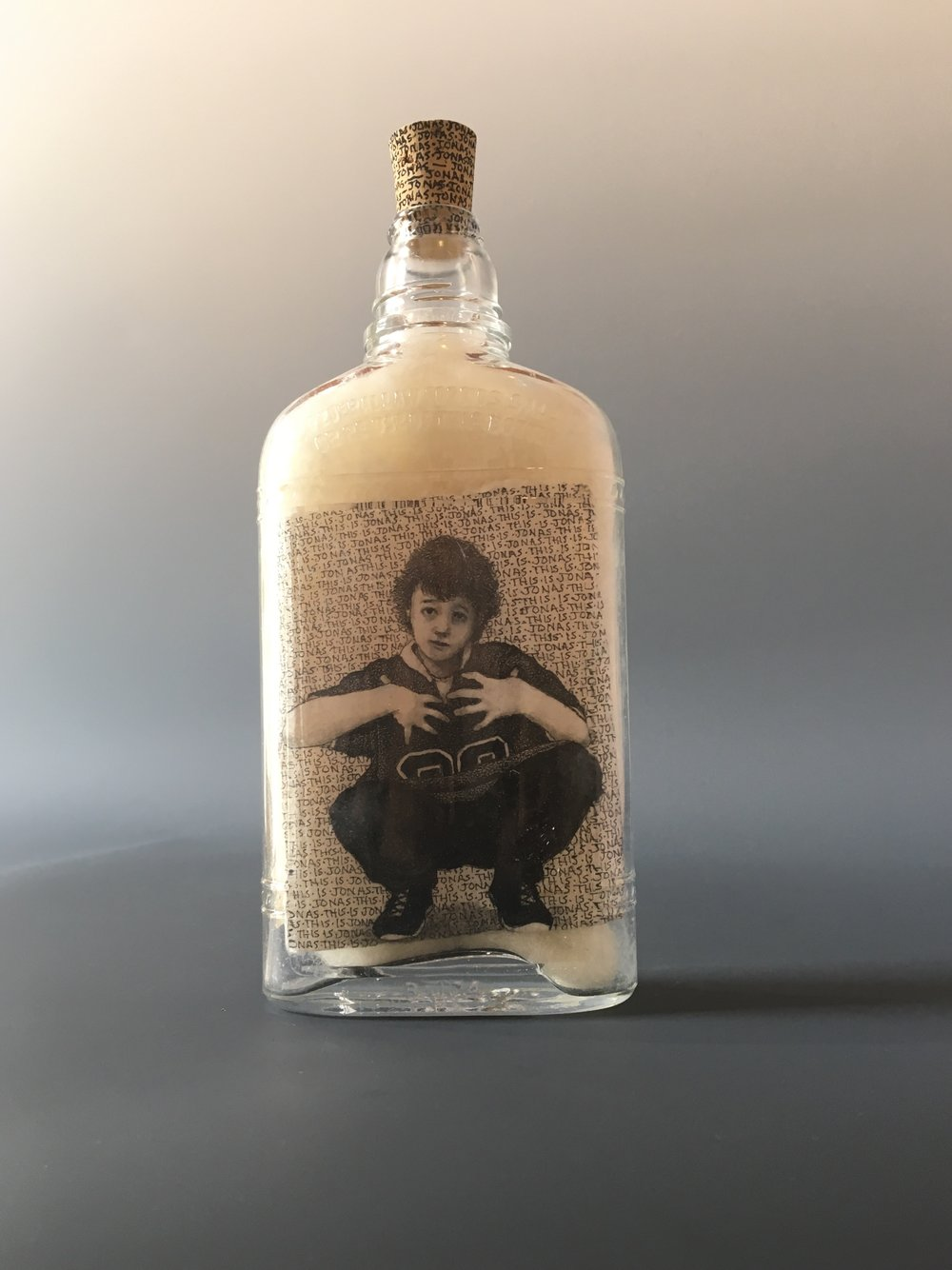This is Jonas...It Wasn't Him!  bottle drawing; ink, graphite, white charcoal on handmade paper, glass bottle, wool