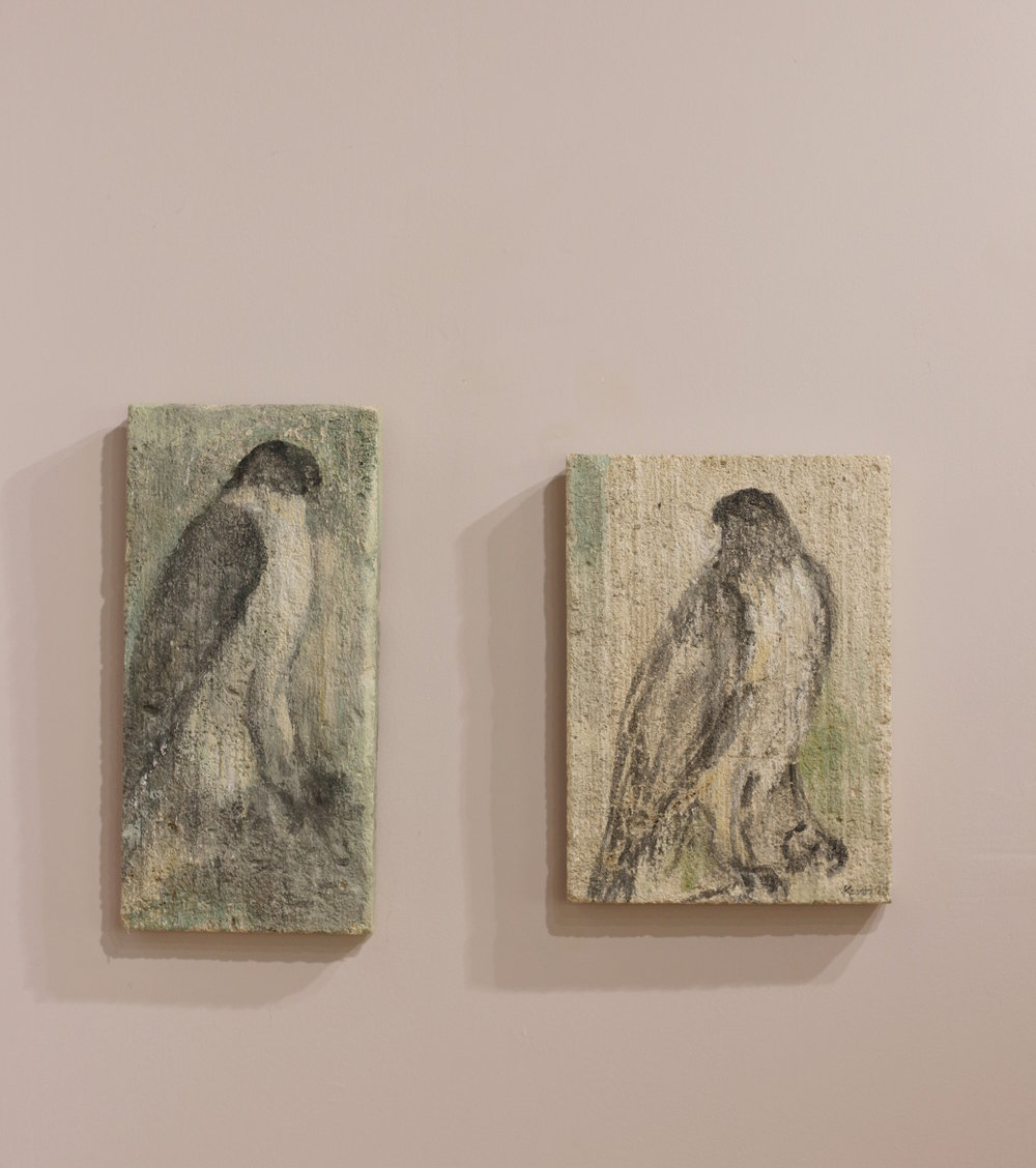 """Raptors"" on limestone tablets by Jane Rosen"