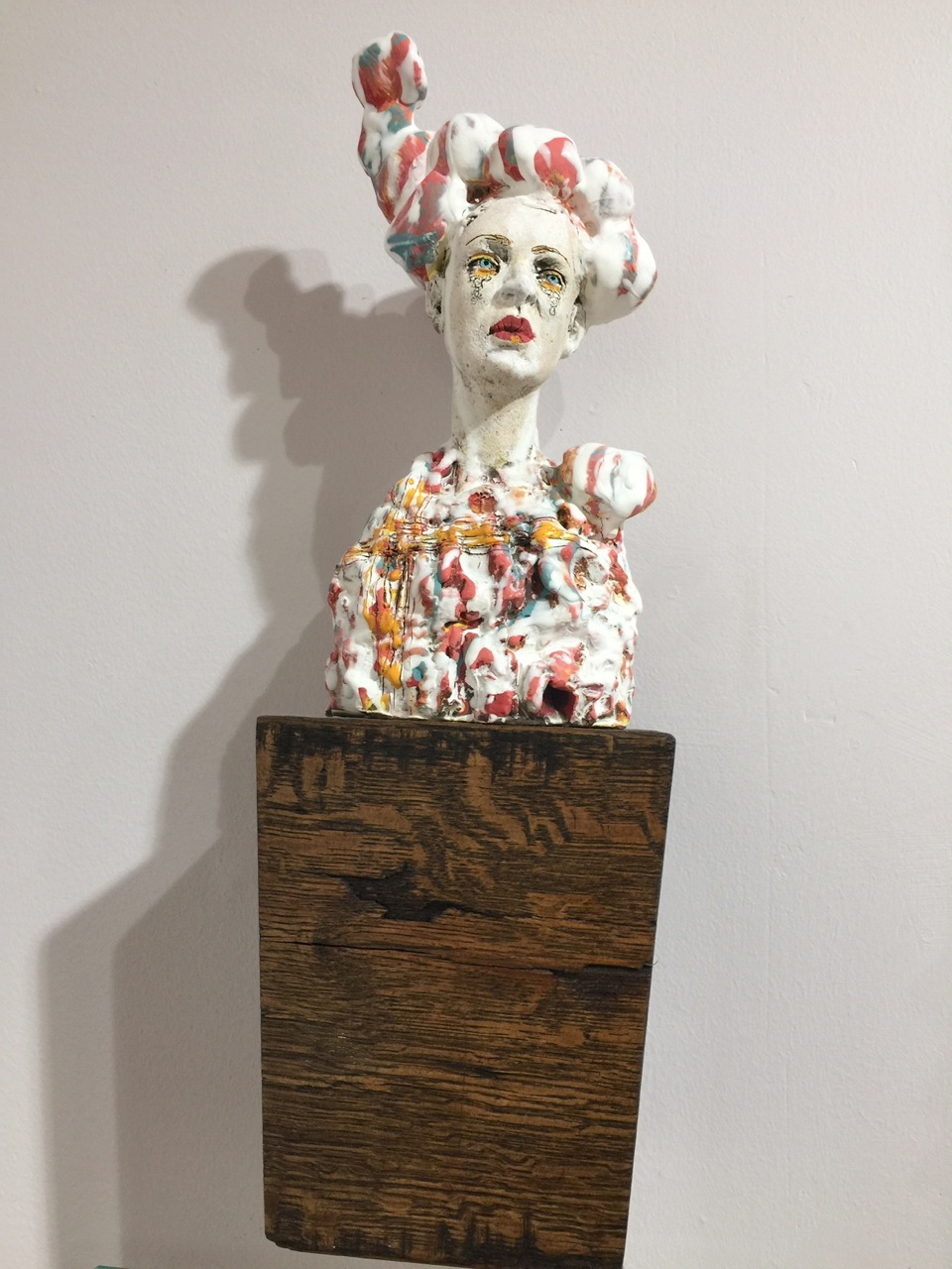 """""""Character Blocks: Irene,"""" 7-10"""" porcelain with many layers of slip and glazes mounted on a block of wood"""
