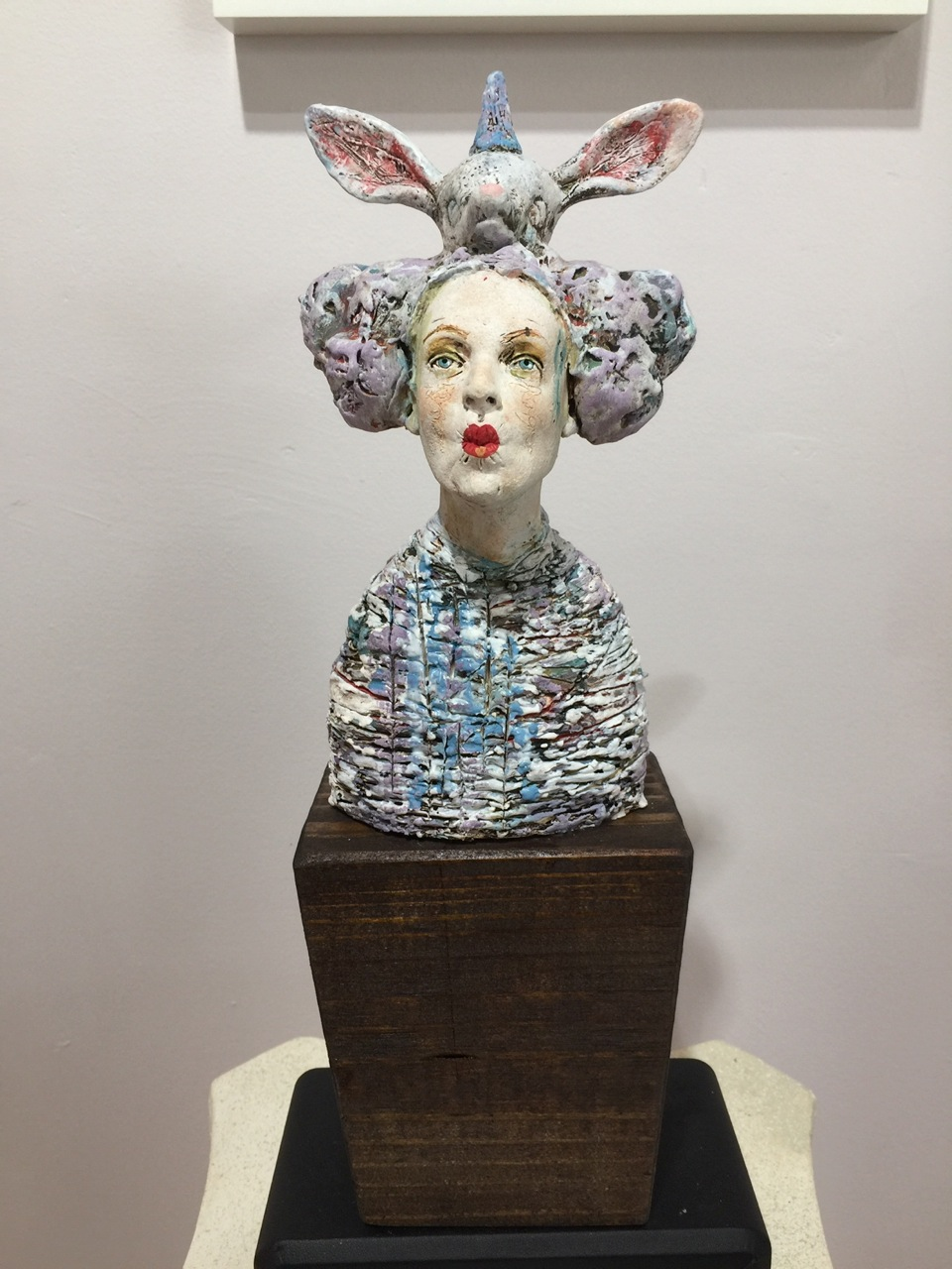 """""""Character Blocks: Darcy,"""" 7-10"""" porcelain with many layers of slip and glazes mounted on a block of wood"""