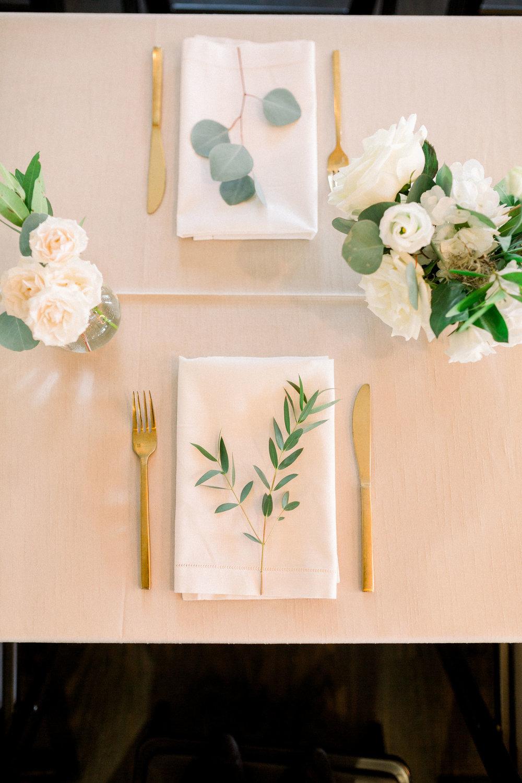 white and greenery wedding place setting