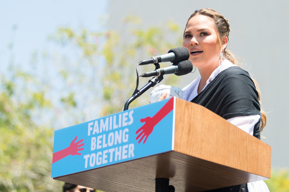 Celebrity Chrissy Teigen delivering a speech at the Keep the Families Together Rally in Los Angeles, California.