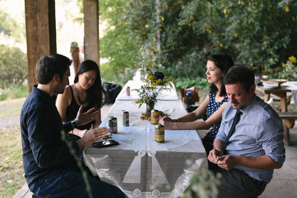Mountain Wedding, Outdoors, Rustic, West Virginia, Maryland Wedding Photographer, DIY, Casual, Guests chatting at picnic table, wildflowers