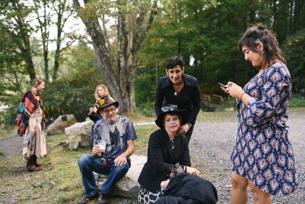 Mountain Wedding, Outdoors, Rustic, West Virginia, Maryland Wedding Photographer, DIY, Casual, guests chatting and watching cat in bowtie