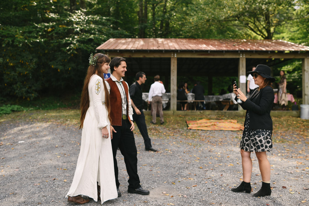 Mountain Wedding, Outdoors, Rustic, West Virginia, Maryland Wedding Photographer, DIY, Casual, bride and groom having picture taken by guests