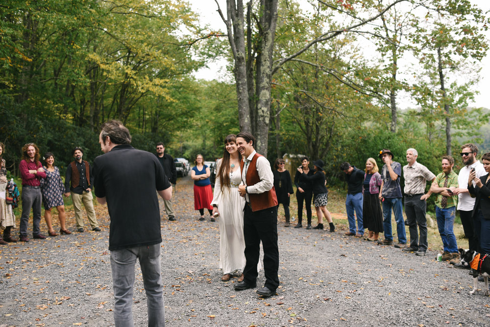 Mountain Wedding, Outdoors, Rustic, West Virginia, Maryland Wedding Photographer, DIY, Casual, Bride and groom laughing inside circle of friends and guests