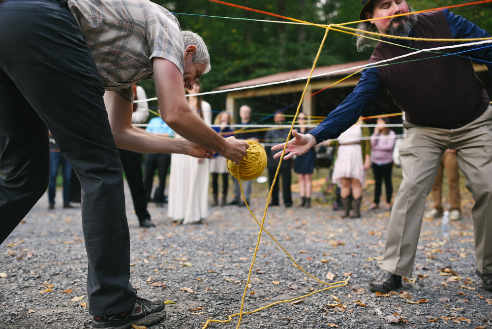 Mountain Wedding, Outdoors, Rustic, West Virginia, Maryland Wedding Photographer, DIY, Casual, Guests passing yarn at yarn weaving ceremony