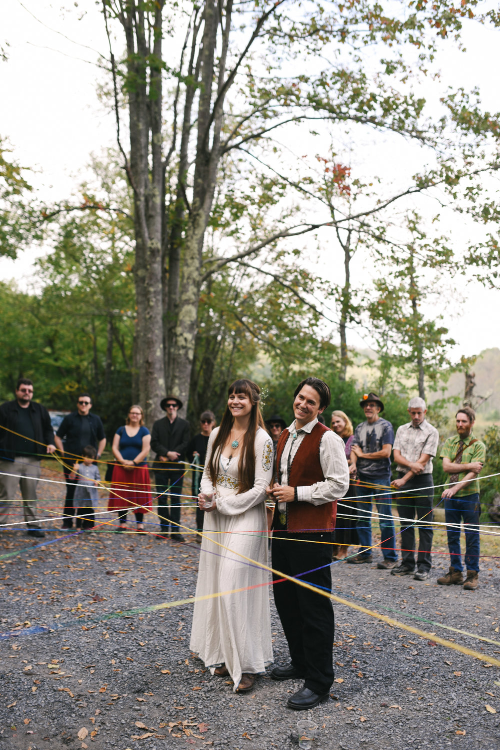 Mountain Wedding, Outdoors, Rustic, West Virginia, Maryland Wedding Photographer, DIY, Casual, bride and groom smiling together inside circle of friends, yarn ceremony