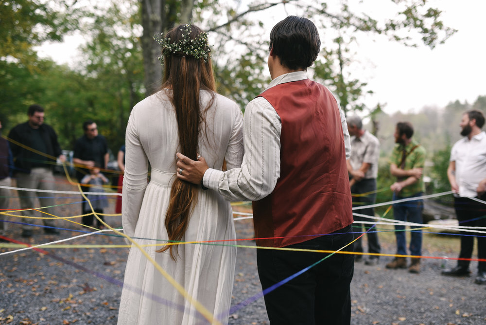 Mountain Wedding, Outdoors, Rustic, West Virginia, Maryland Wedding Photographer, DIY, Casual, bride and groom from behind in circle of guests, yarn weaving ceremony