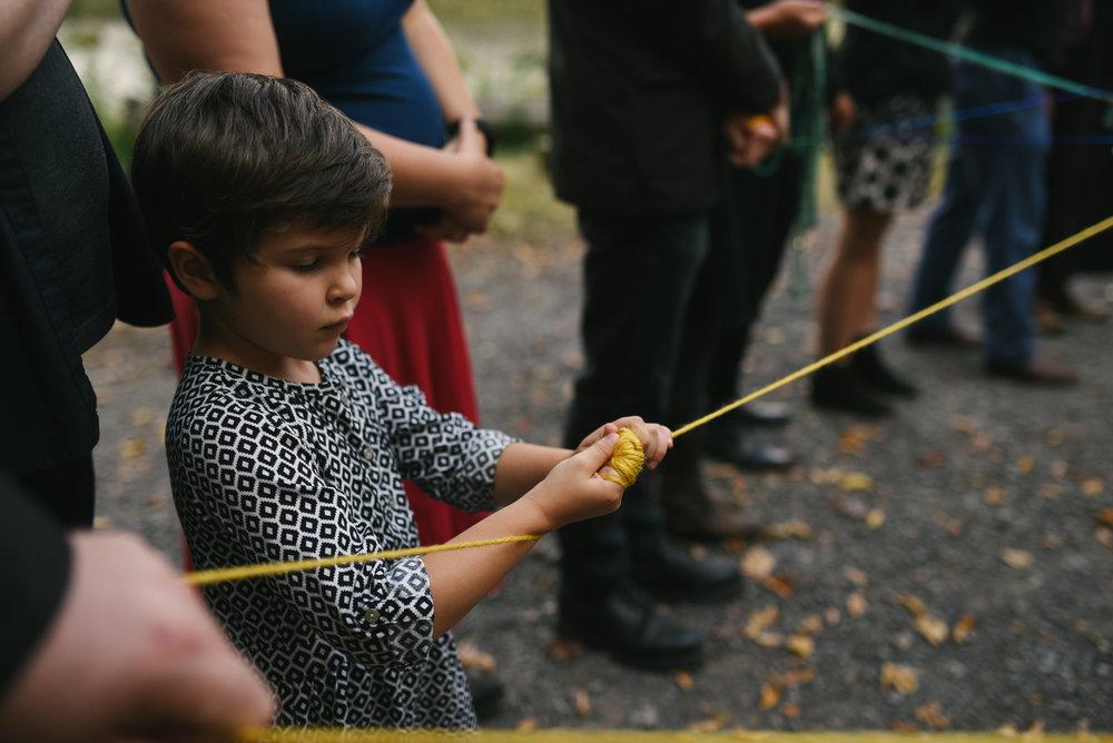 Mountain Wedding, Outdoors, Rustic, West Virginia, Maryland Wedding Photographer, DIY, Casual, little girl at yarn weaving ceremony