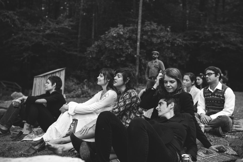 Mountain Wedding, Outdoors, Rustic, West Virginia, Maryland Wedding Photographer, DIY, Casual, black and white photo of bride and friends sitting in grass outside