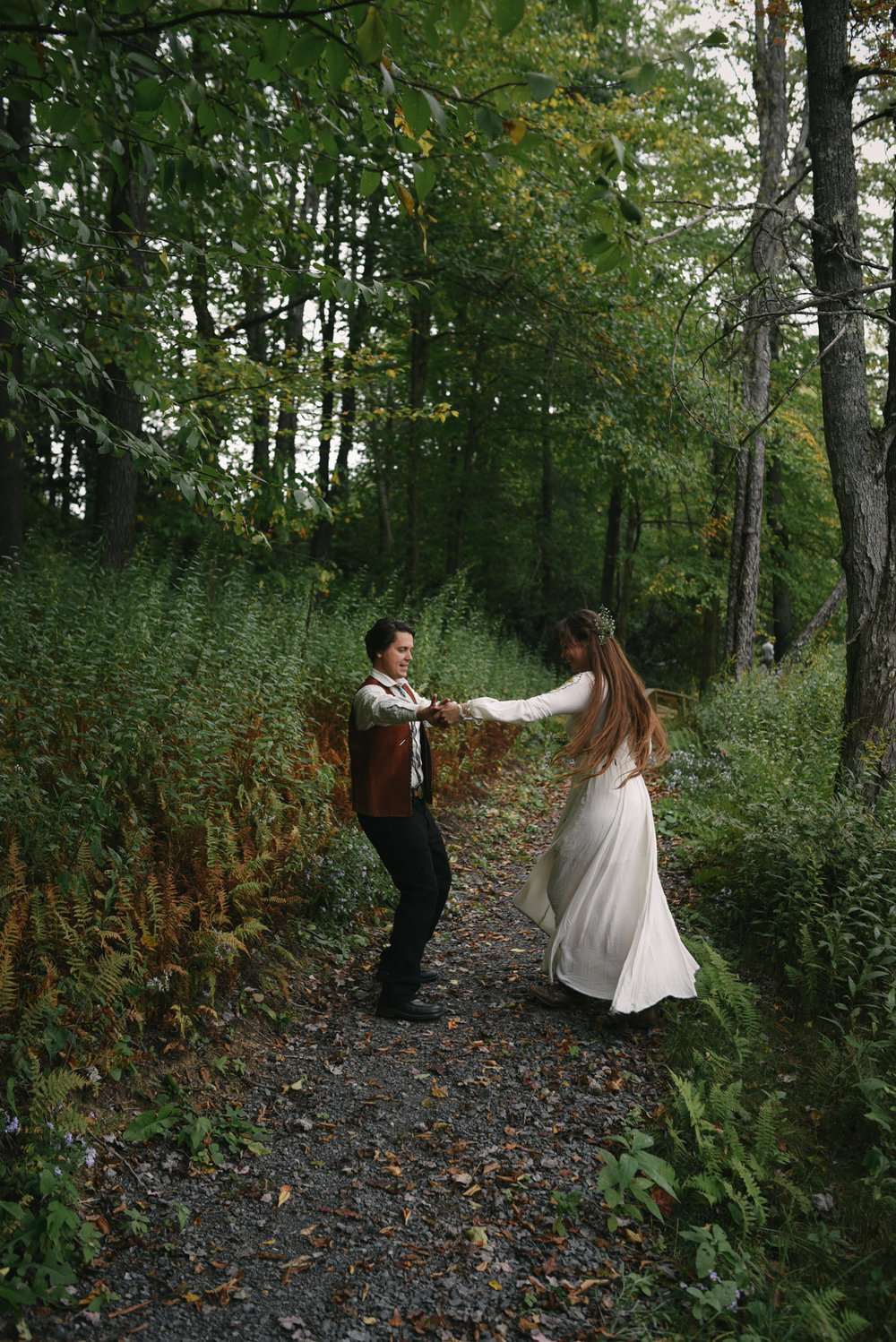 Mountain Wedding, Outdoors, Rustic, West Virginia, Maryland Wedding Photographer, DIY, Casual, bride and groom dancing on trail in the woods, boho, etherial