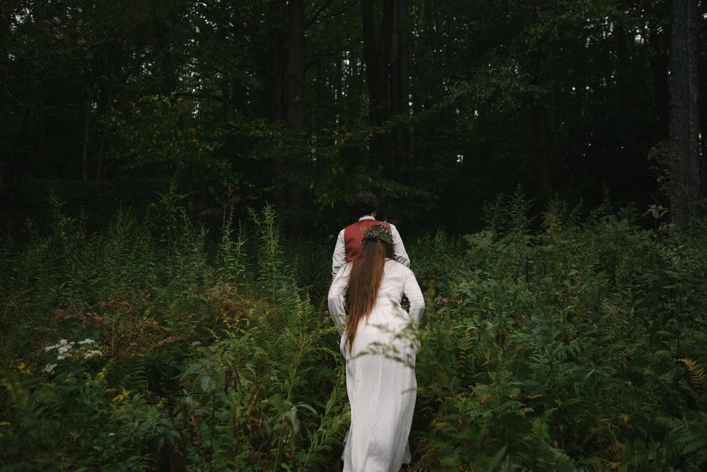 Mountain Wedding, Outdoors, Rustic, West Virginia, Maryland Wedding Photographer, DIY, Casual, bride and groom walking through woods, baby's breath in bride's hair