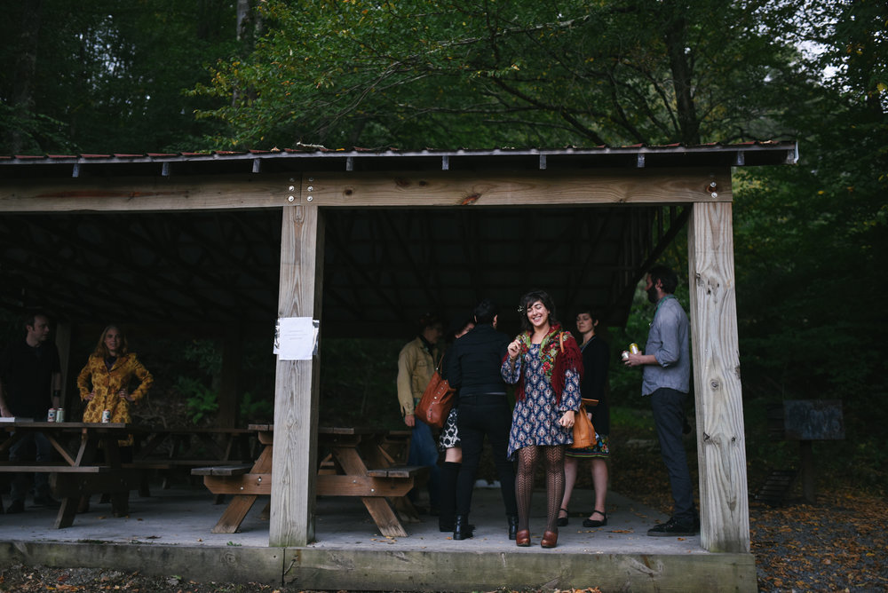 Mountain Wedding, Outdoors, Rustic, West Virginia, Maryland Wedding Photographer, DIY, Casual, candid photo of friends at picnic tables