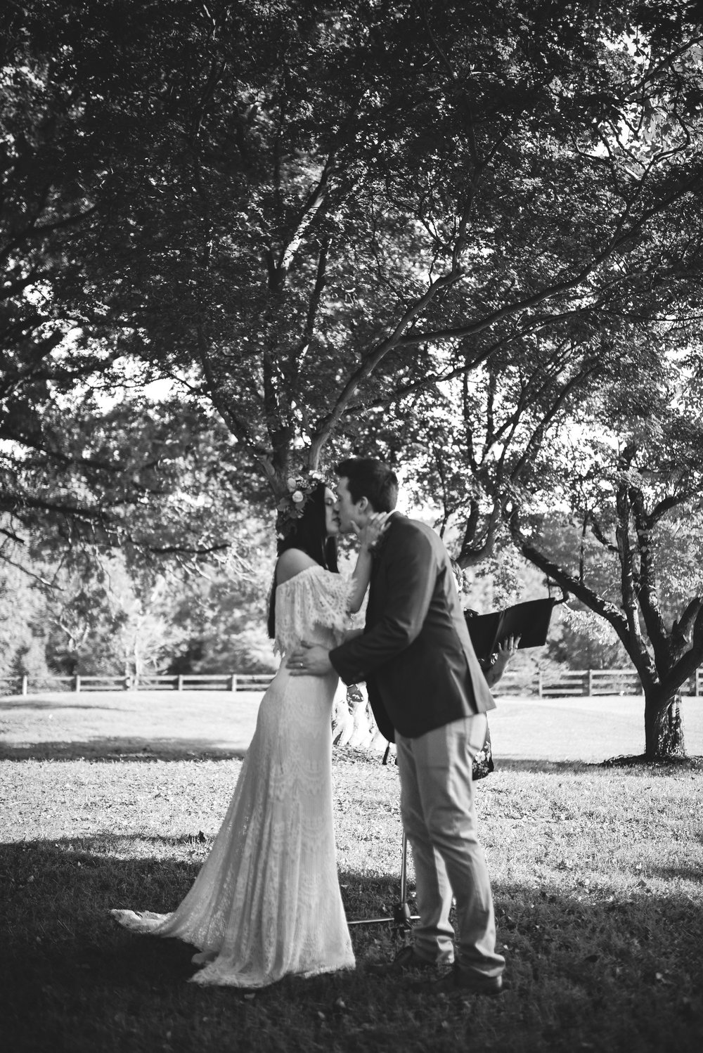 Maryland, Eastern Shore, Baltimore Wedding Photographer, Romantic, Boho, Backyard Wedding, Nature, Black and White Photo, First Kiss, Bride and Groom Share First Kiss