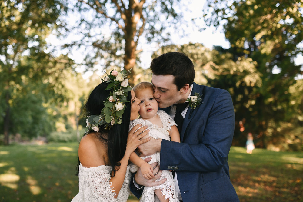 Maryland, Eastern Shore, Baltimore Wedding Photographer, Romantic, Boho, Backyard Wedding, Nature, Bride and Groom Kissing Little Girl, Flower Crown, Michael Designs Florist