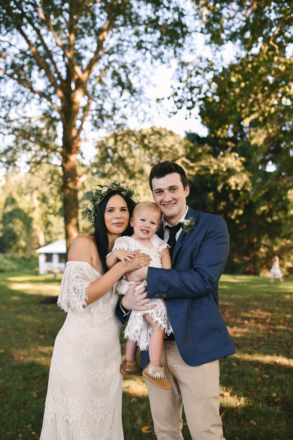 Maryland, Eastern Shore, Baltimore Wedding Photographer, Romantic, Boho, Backyard Wedding, Nature, Bride and Groom Holding Little Girl in Lace Dress, Flower Crown