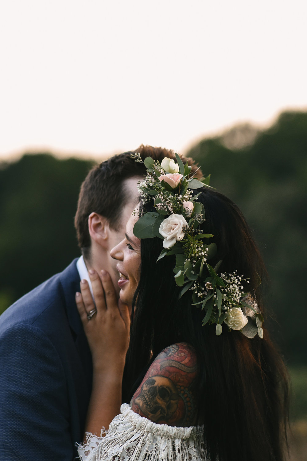 Maryland, Eastern Shore, Baltimore Wedding Photographer, Romantic, Boho, Backyard Wedding, Nature, Groom Kissing Bride on the Cheek, Michael Designs Florist, Bride Smiling with Groom, Flower Crown, Tattooed Bride