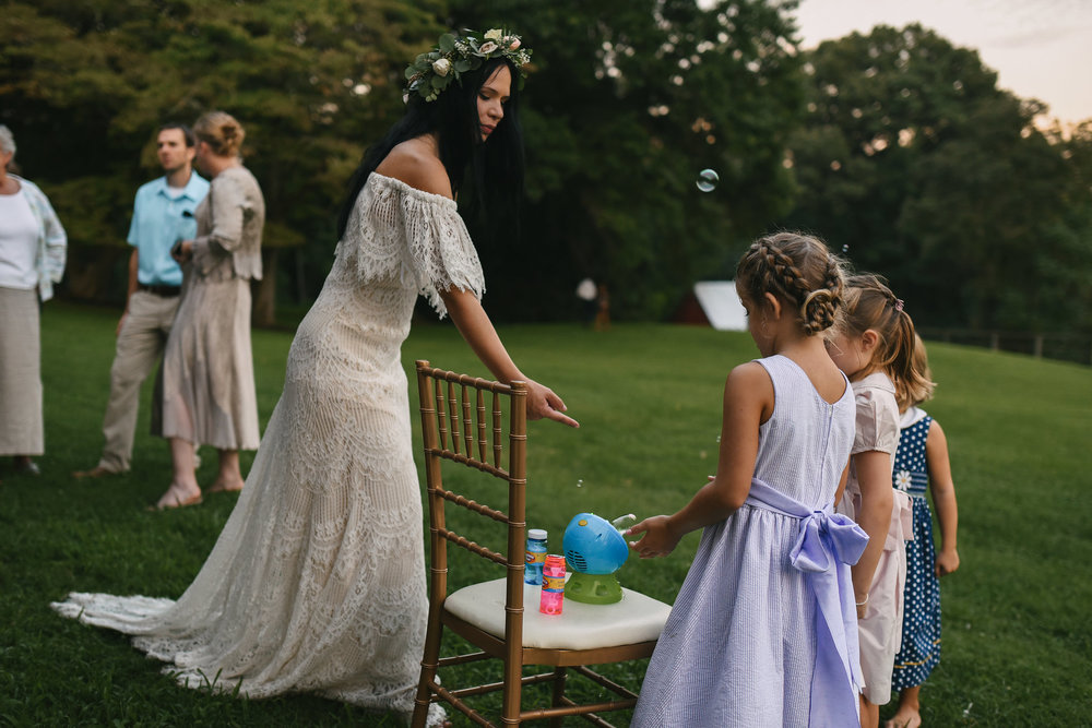 Maryland, Eastern Shore, Baltimore Wedding Photographer, Romantic, Boho, Backyard Wedding, Nature, Bride Playing with Kids at Reception, Daughters of Simone Lace Wedding Dress, Flower Crown