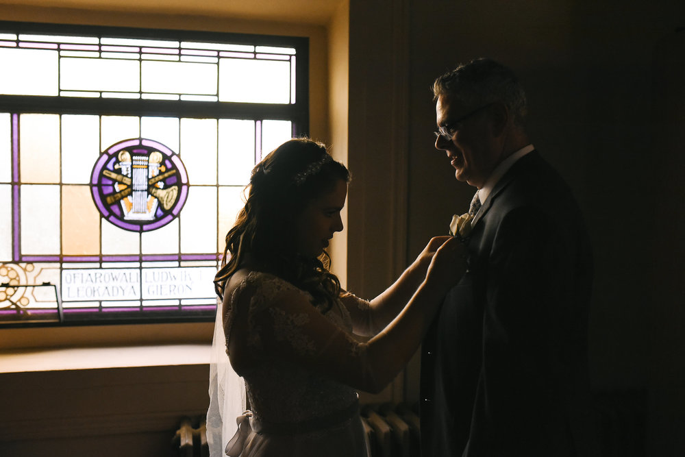 Baltimore, Canton, Church Wedding, Modern, Outdoors, Maryland Wedding Photographer, Romantic, Classic, Candid photo, bride helping father with boutonniere, St. Casimir Church