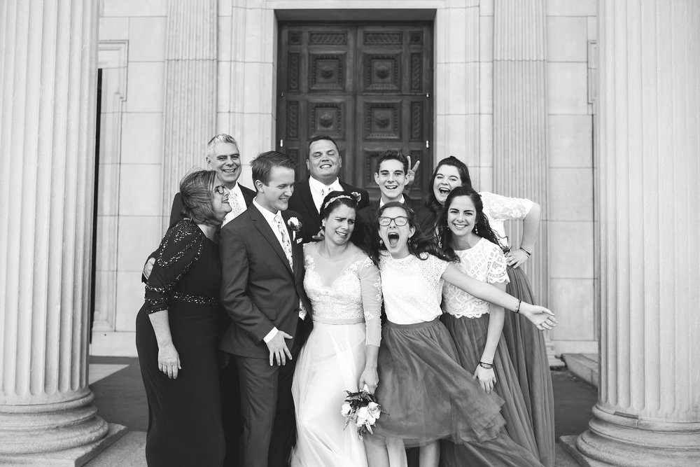 Baltimore, Canton, Church Wedding, Modern, Outdoors, Maryland Wedding Photographer, Romantic, Classic, St. Casimir Church, Silly portrait of bride and groom with family, black and white photo, lace bridesmaid dresses