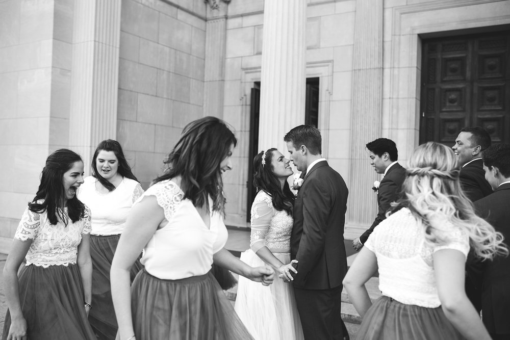 Baltimore, Canton, Church Wedding, Modern, Outdoors, Maryland Wedding Photographer, Romantic, Classic, St. Casimir Church, Bride and groom holding each other and smiling while encircled by wedding party, black and white photo