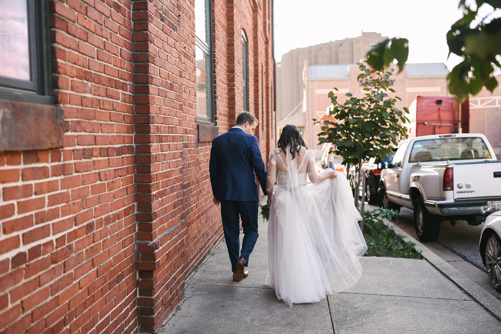 Baltimore, Canton, Church Wedding, Modern, Outdoors, Maryland Wedding Photographer, Romantic, Classic, St. Casimir Church, bride and groom holding hands and walking down sidewalk, downtown, lace dress with sleeves