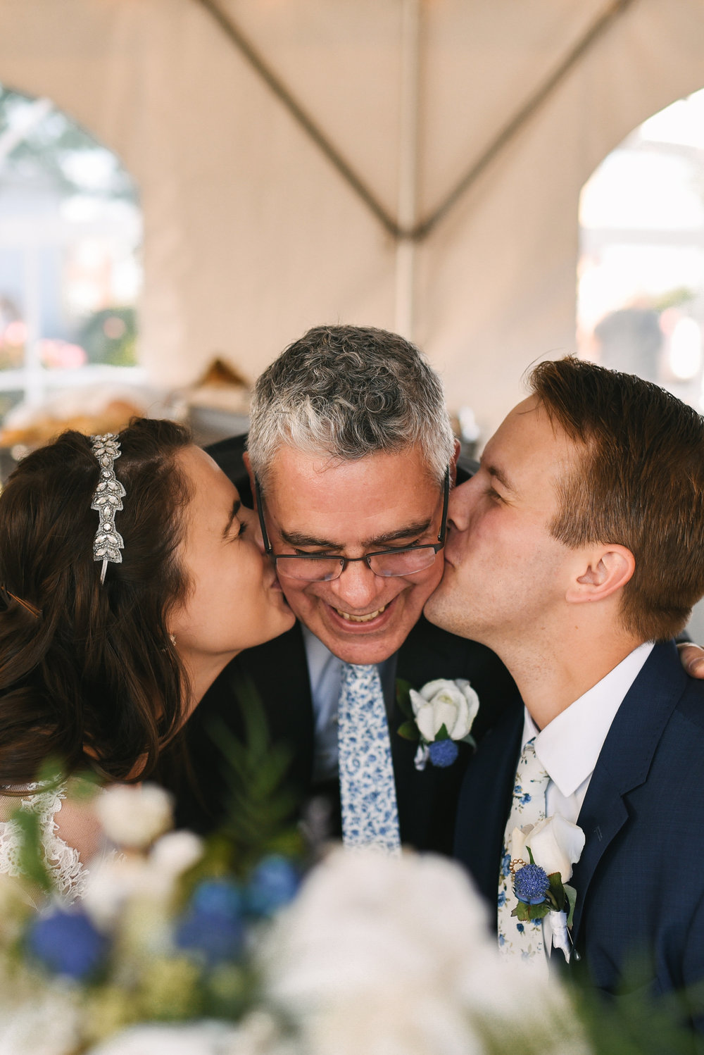 Baltimore, Canton, Modern, Outdoor Reception, Maryland Wedding Photographer, Romantic, Classic, Boston Street Pier Park, Bride and groom kissing father of the bride on the cheek