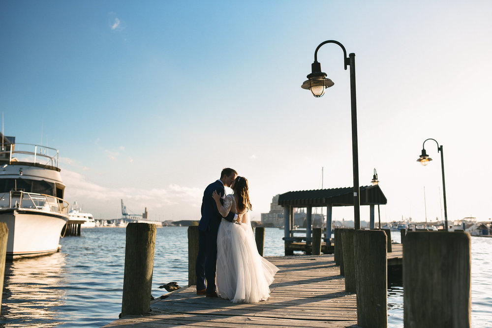 Baltimore, Canton, Modern, Outdoor Reception, Maryland Wedding Photographer, Romantic, Classic, Boston Street Pier Park, Bride and Groom kissing at Waterfront, Portrait