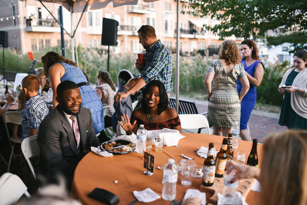 Baltimore, Canton, Modern, Outdoor Reception, Maryland Wedding Photographer, Romantic, Classic, Boston Street Pier Park, Friends smiling seated at Wedding Reception