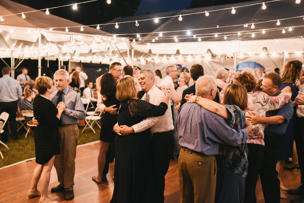 Baltimore, Canton, Modern, Outdoor Reception, Maryland Wedding Photographer, Romantic, Classic, Boston Street Pier Park, Guests slow dancing under string lights, Outside in the evening