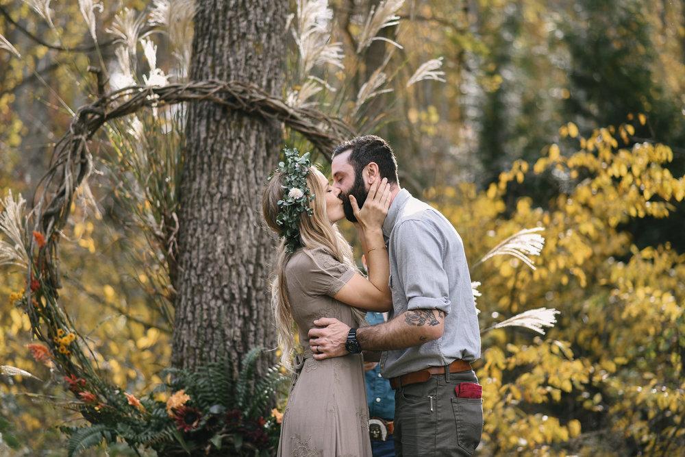Baltimore, Maryland Wedding Photographer, Backyard Wedding, DIY, Rustic, Casual, Fall Wedding, Woodland, Bride and Groom Share First Kiss, Butterbee Farm Flower Crown, Levi's