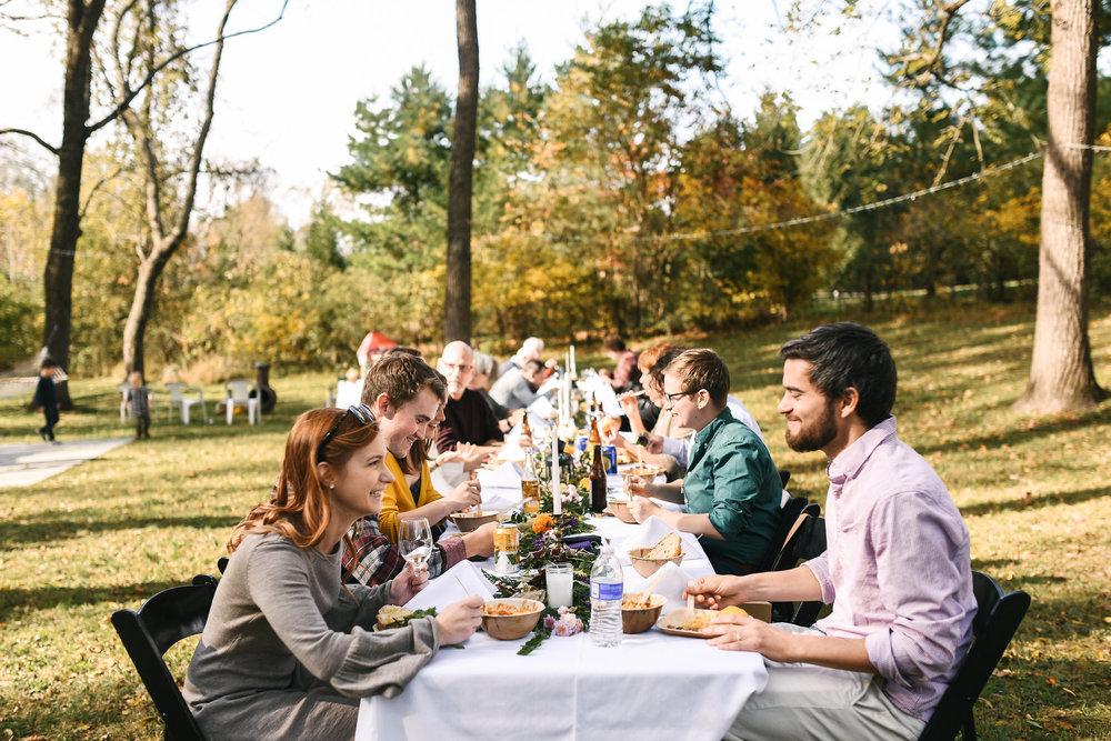 Baltimore, Maryland Wedding Photographer, Backyard Wedding, DIY, Rustic, Casual, Fall Wedding, Woodland, Friends and Family Sitting at Banquet Table Enjoying Food, Crooked Fence Farm
