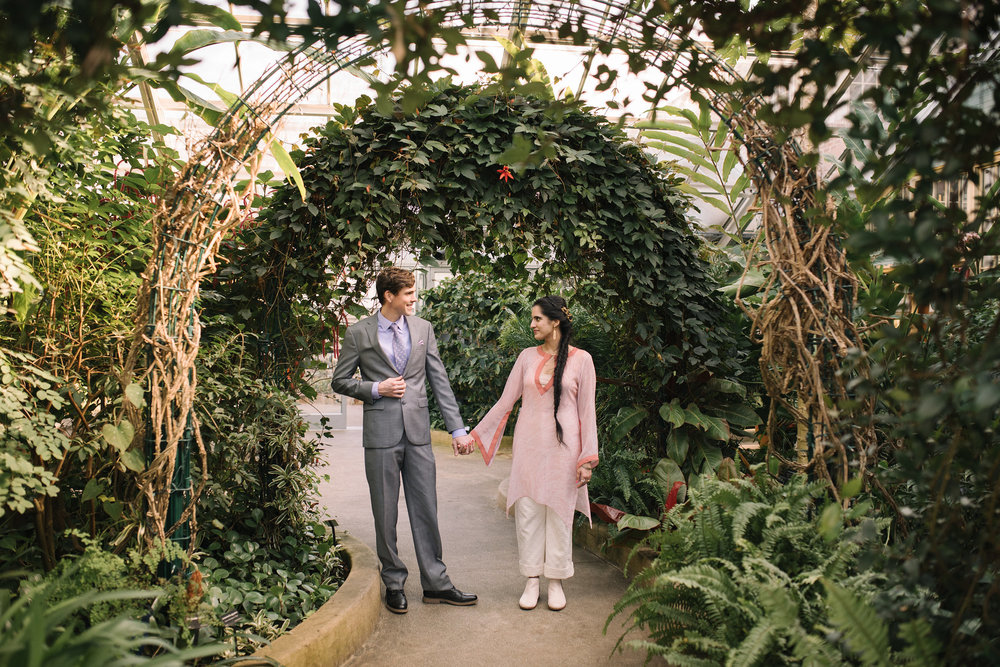 Elopement, Rawlings Conservatory, Greenhouse, Baltimore Wedding Photographer, Indian American, Outdoor, Nature, Romantic, Garden, Floral Archway, Bride and Groom Holding Hands, Sari, Gray Suit