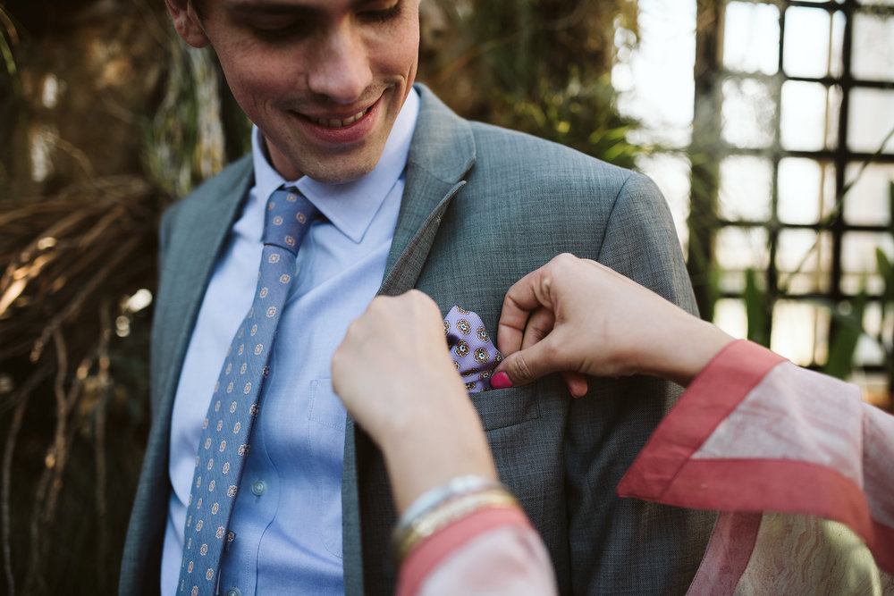 Elopement, Weekday Wedding, Baltimore, Rawlings Conservatory, Greenhouse, Maryland Wedding Photographer, Indian American, Nature, Romantic, Garden, Bride Adjusting Grooms Suit, Gray Suit