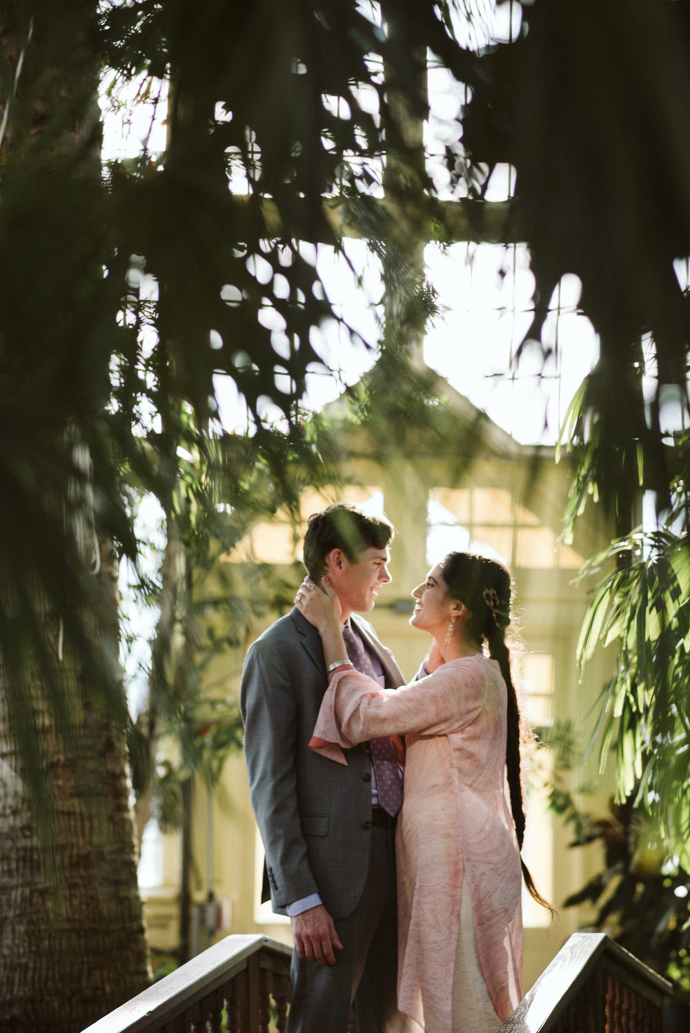 Elopement, Baltimore, Rawlings Conservatory, Greenhouse, Maryland Wedding Photographer, Indian American, Nature, Romantic, Garden, Pink Sari, Braids, Bride and Groom Hugging, Candid Photo