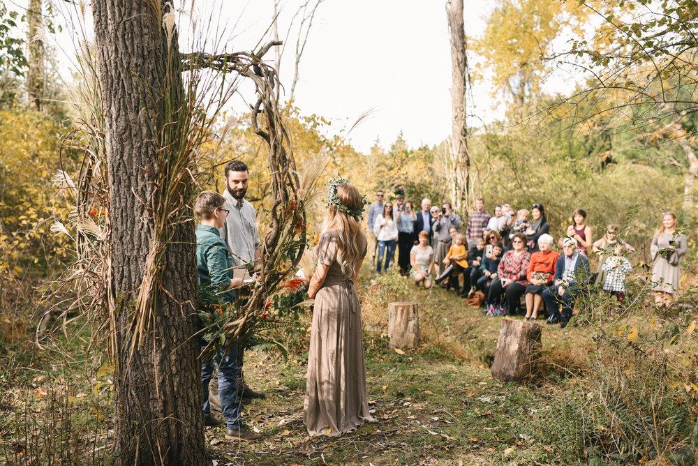 Baltimore, Maryland Wedding Photographer, Backyard Wedding, DIY, Rustic, Casual, Fall Wedding, Woodland, Couple Standing in Front of Wreath