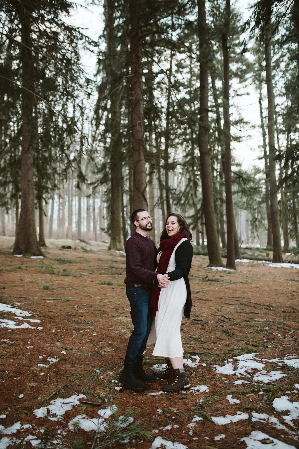 Baltimore County, Loch Raven Reservoir, Maryland Wedding Photographer, Winter, Engagement Photos, Nature, Romantic, Clean and Classic, Couple Dancing Together in the Forest, White Dress with Hiking Boots