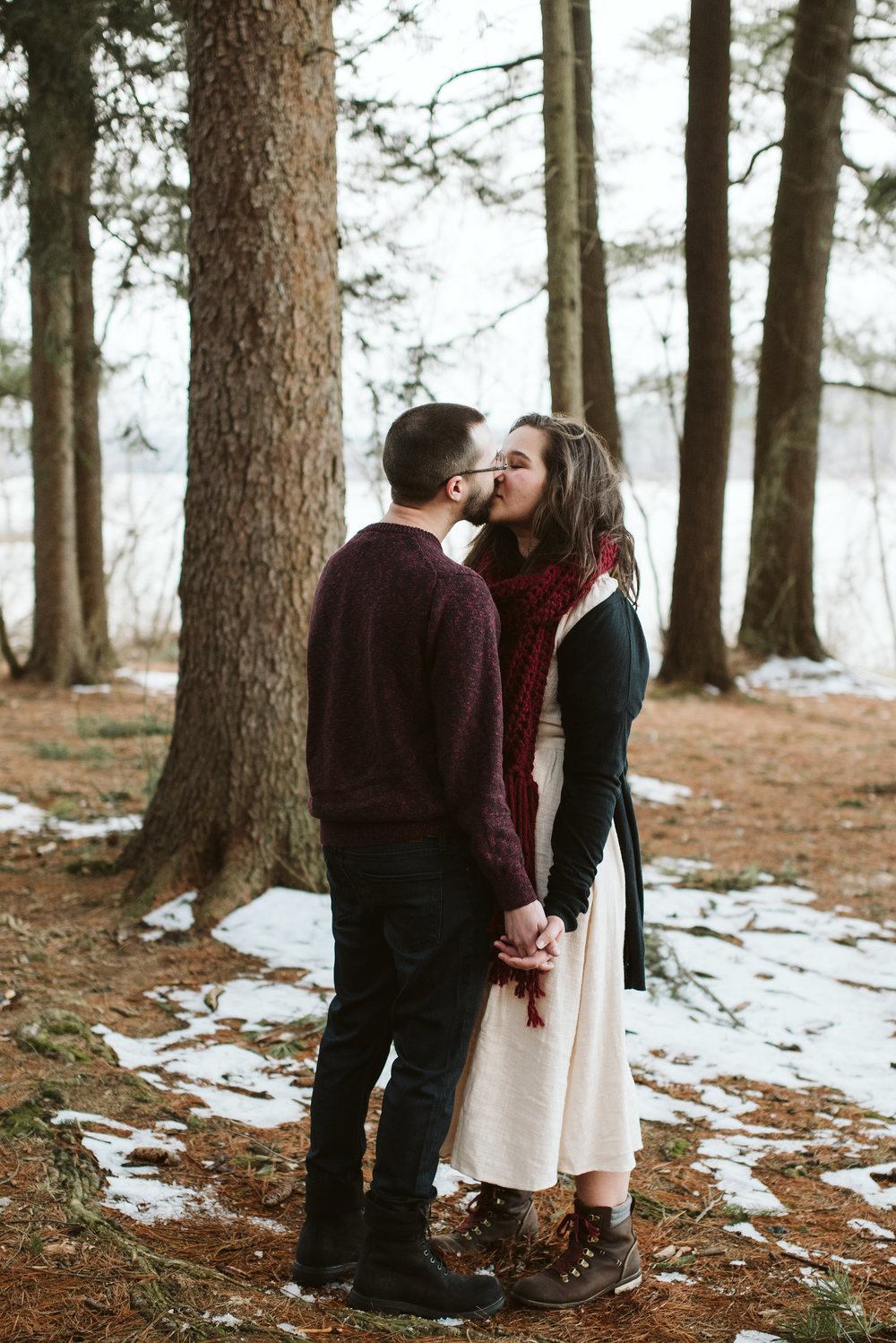 Baltimore County, Loch Raven Reservoir, Maryland Wedding Photographer, Winter, Engagement Photos, Nature, Romantic, Clean and Classic, Bride and Groom Kissing in the Trees, White Dress, Burgundy Sweater