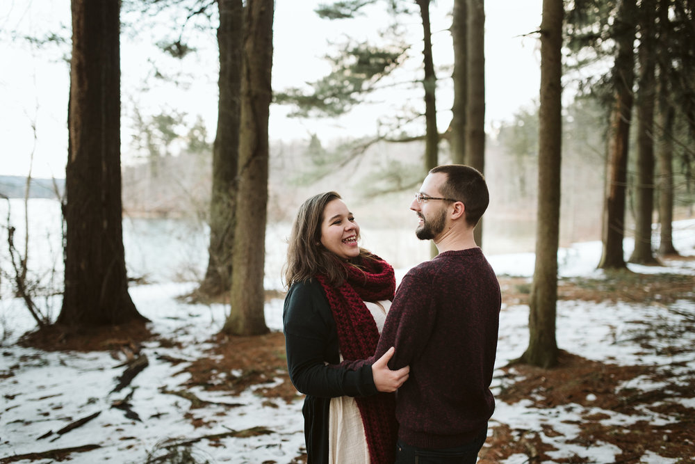Baltimore County, Loch Raven Reservoir, Maryland Wedding Photographer, Winter, Engagement Photos, Nature, Romantic, Clean and Classic, Bride and Groom Laughing Together Outside with Snow on the Ground