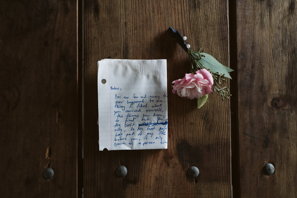 groom's wedding vows written on lined paper